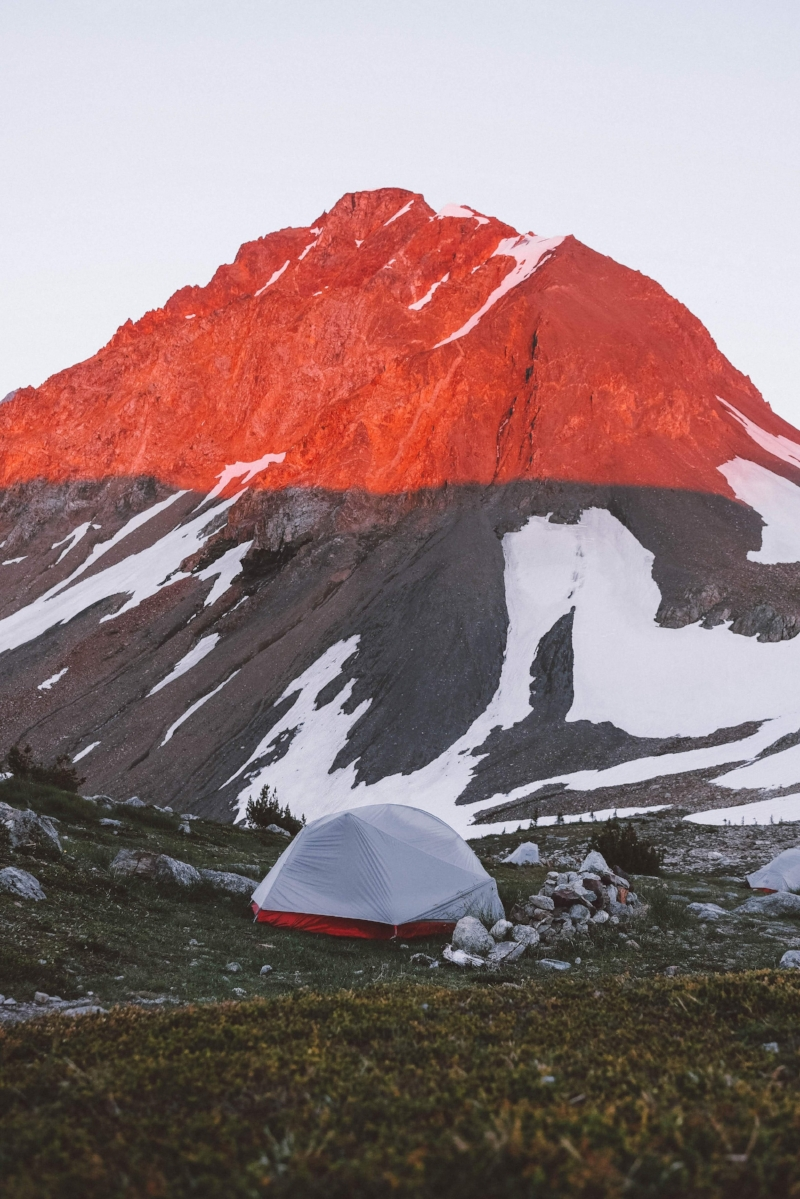 When camping on rocky terrain or areas where there are likely rocks embedded in the ground (like in this photo), it can be difficult to get stakes far enough into the dirt to hold up your tent. With a freestanding tent, this is less of a problem. If your tent isn't freestanding, you may still be able to camp in that spot. However, it requires learning how to stake out your tent using rocks and other natural material. Photo by  Wenni Zhou  on  Unsplash