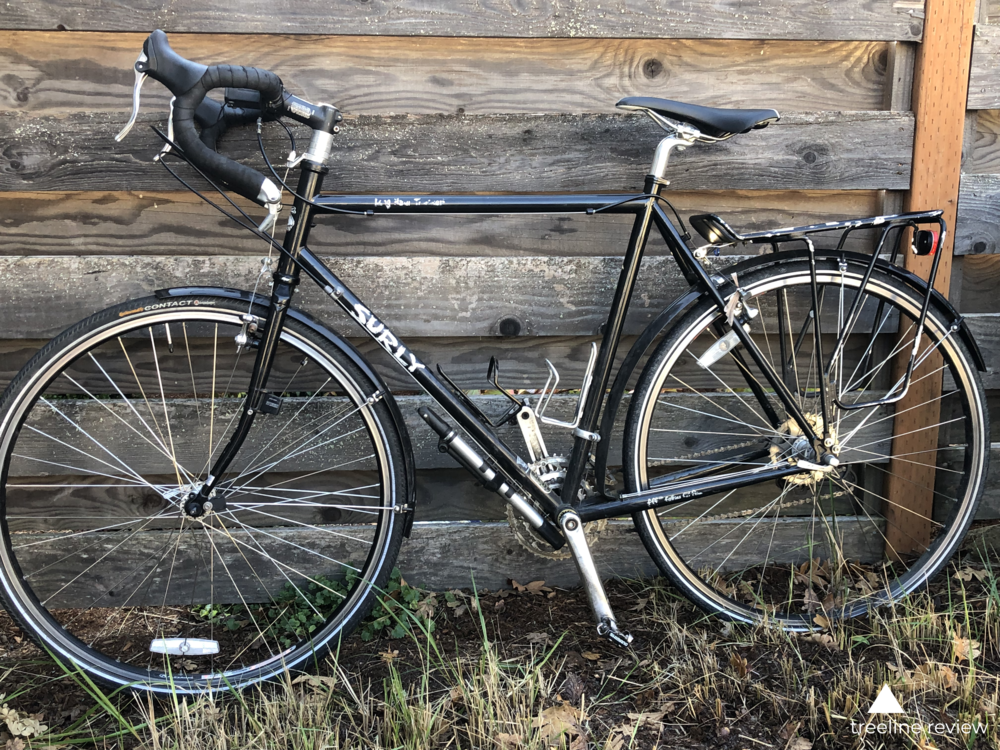 The Surly Long Haul Trucker is our top pick for best touring bike with rim brakes, shown here in black.