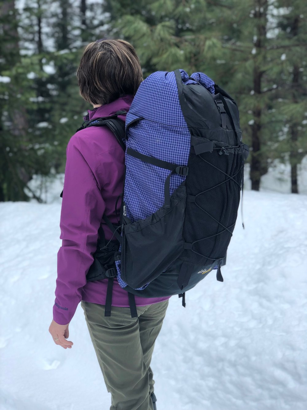 The ULA Catalyst has a mesh pocket as well as suspension cord.   Note the slanted side pockets which make it easier to access water bottles.   Photo by Eric Weeks.