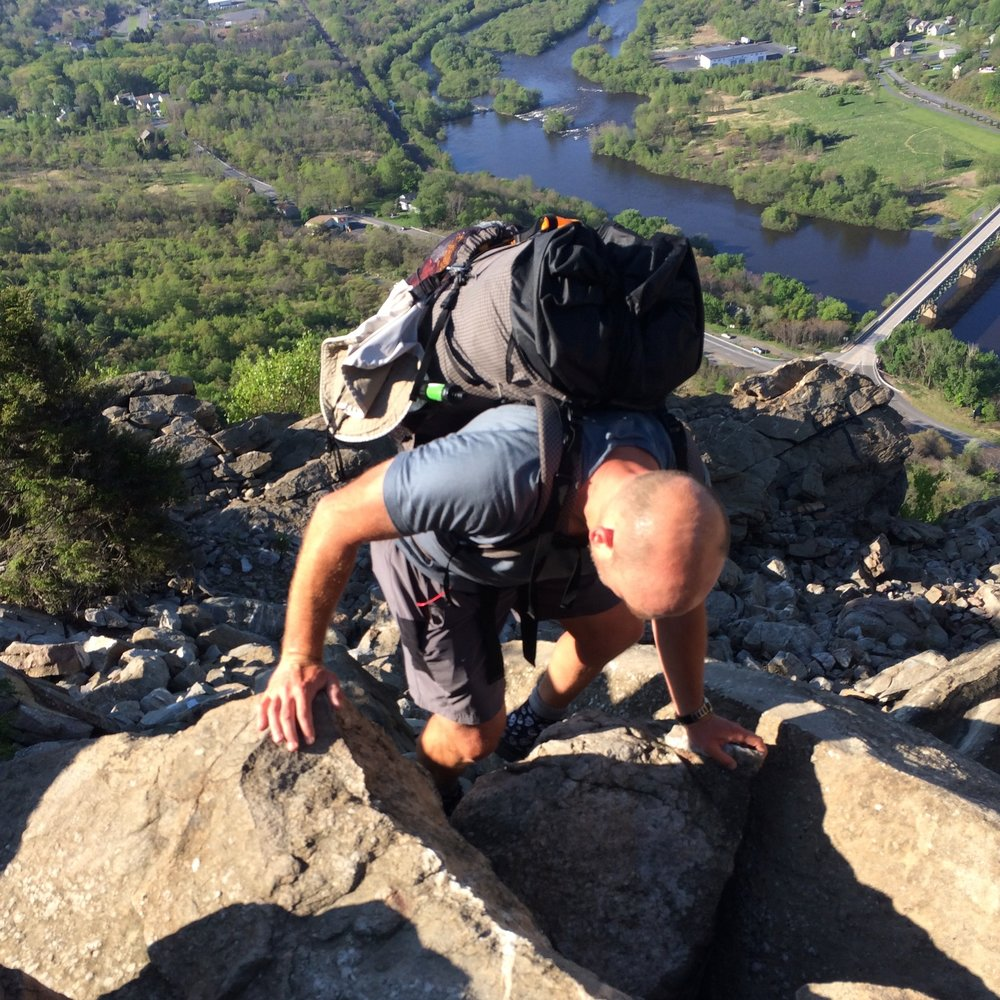 The author scrambling unsteady boulders on the Appalachian Trail near Lehigh Gap with the MLD Exodus.   Photo by Naomi Hudetz.