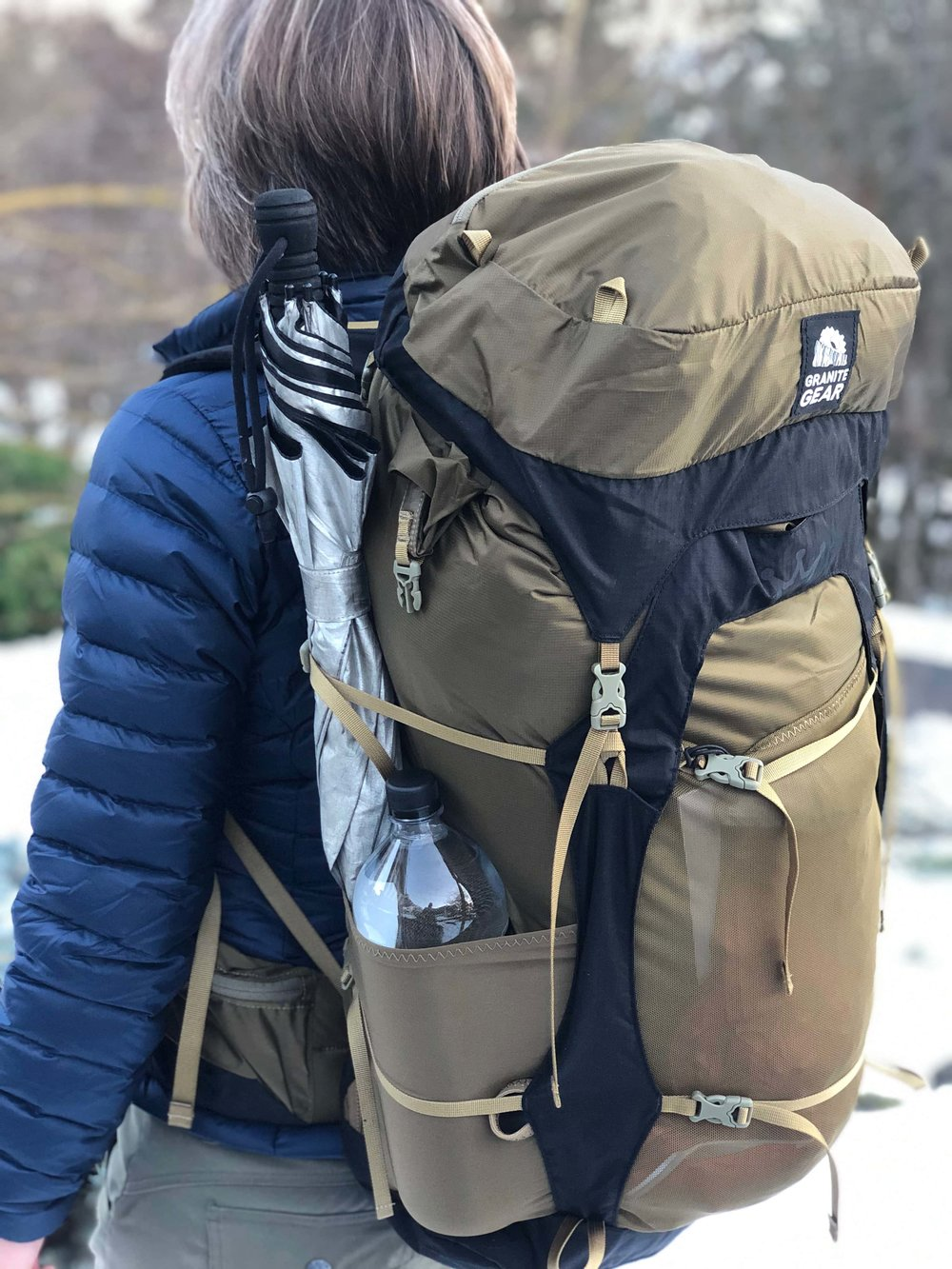 The Granite Gear Crown2 60 is our budget pick. The side pocket holds a 1 liter water bottle and a full size hiking umbrella.   Photo by Mike Unger.