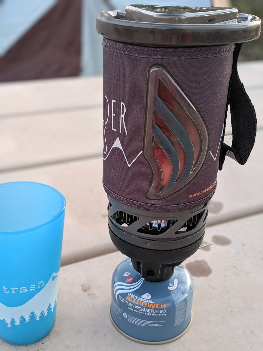 The Jetboil Flash has a temperature-changing indicator on its sleeve that goes from blue to red when the water is boiling hot.   Photo courtesy Liz Thomas.