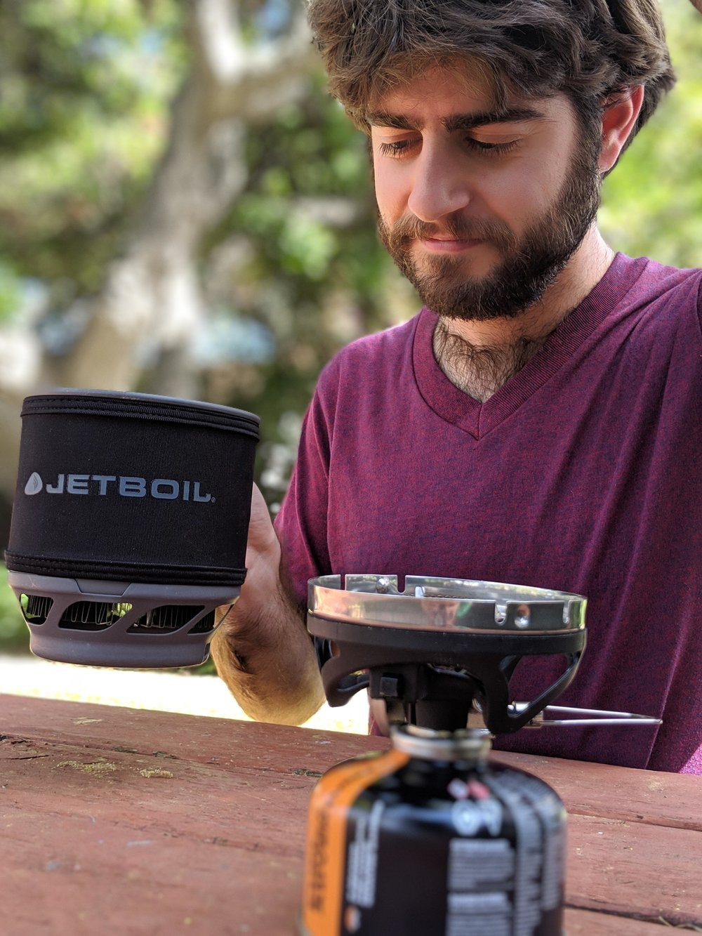 The JetBoil MiniMo comes with full handles and a squat pot that fits into backpacks better than most integrated stoves.   Photo courtesy Liz Thomas.
