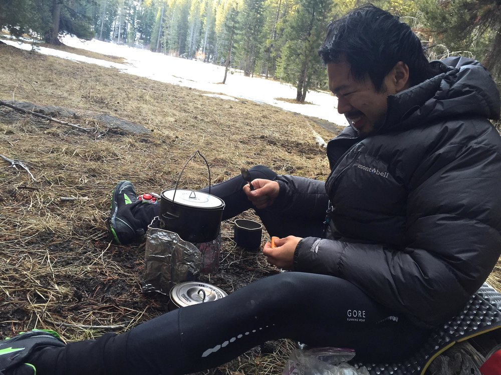 Off Trail On Track    guide Duncan Cheung using a backpacking stove.   Photo courtesy Duncan Cheung