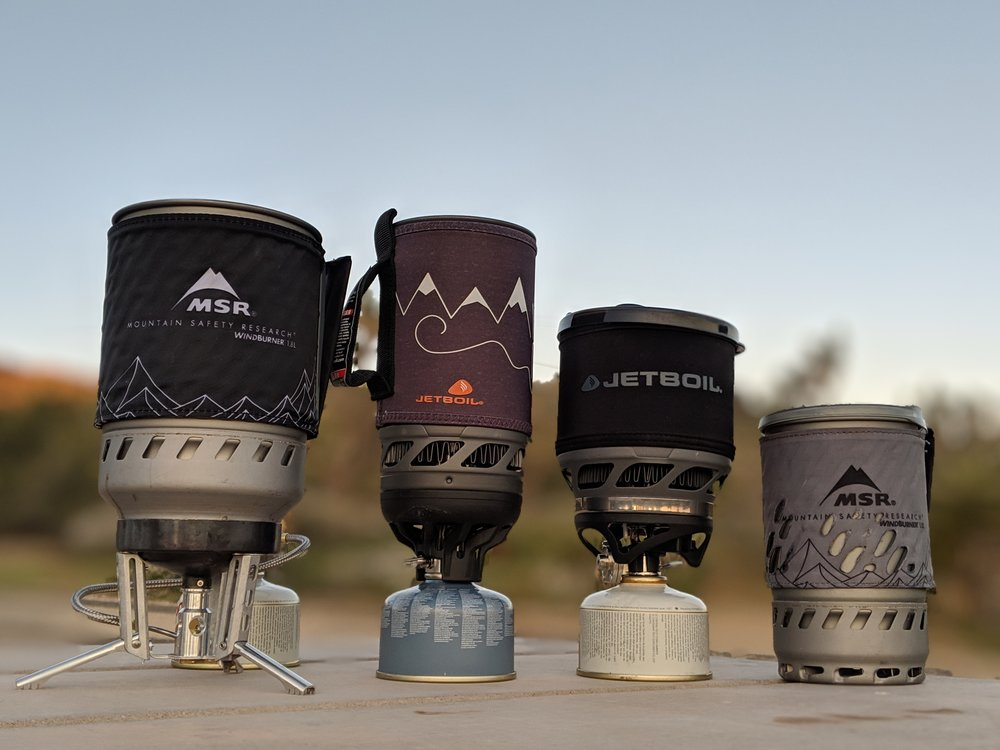 The four integrated backpacking stove models we considered.   Photo by Liz Thomas.