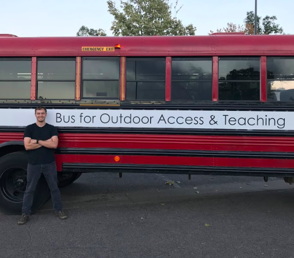 The author with the Bus for Outdoor Access and Teaching, a mobile adventure education program aimed at reducing cost and increasing accessibility of outdoor education.   Photo courtesy Micah Leinbach.