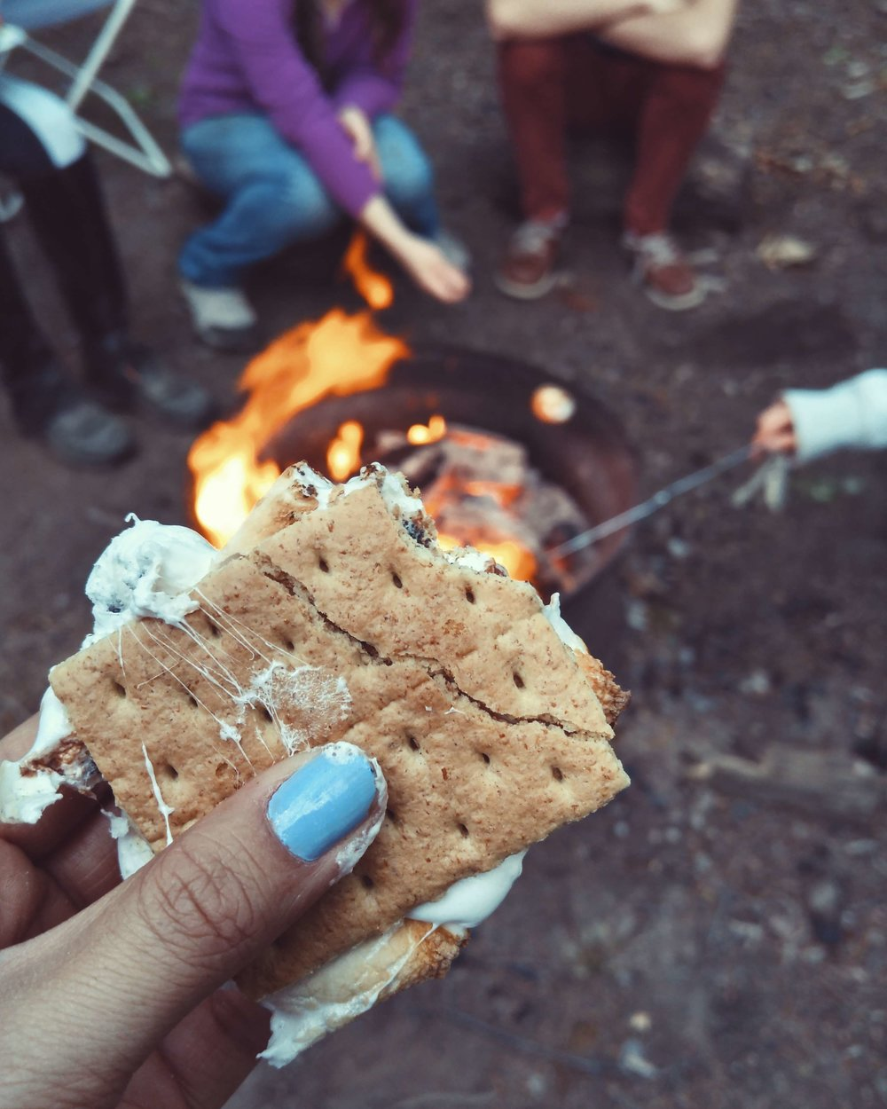A tent that is easy to set up means you have more time to do the camping stuff you love, like making s'mores.   Photo by    Autumn Mott Rodeheaver    on    Unsplash