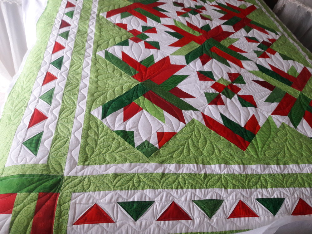 The lady who pieced this quilt changed the border layout somewhat. It looks like she added extra borders which is great way to enlarge a quilt