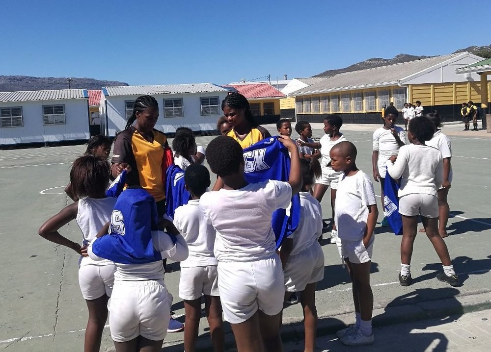 Coaches from Masiphumelele preparing their girls for a netball tournament