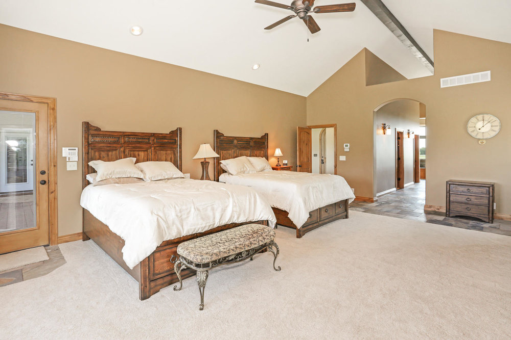 123 Anywhere St Clearwater KS-large-023-23-Master Bedroom-1500x1000-72dpi.jpg
