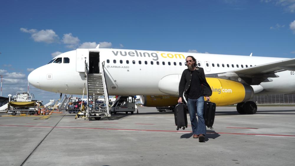 Greg leaves airplane.png