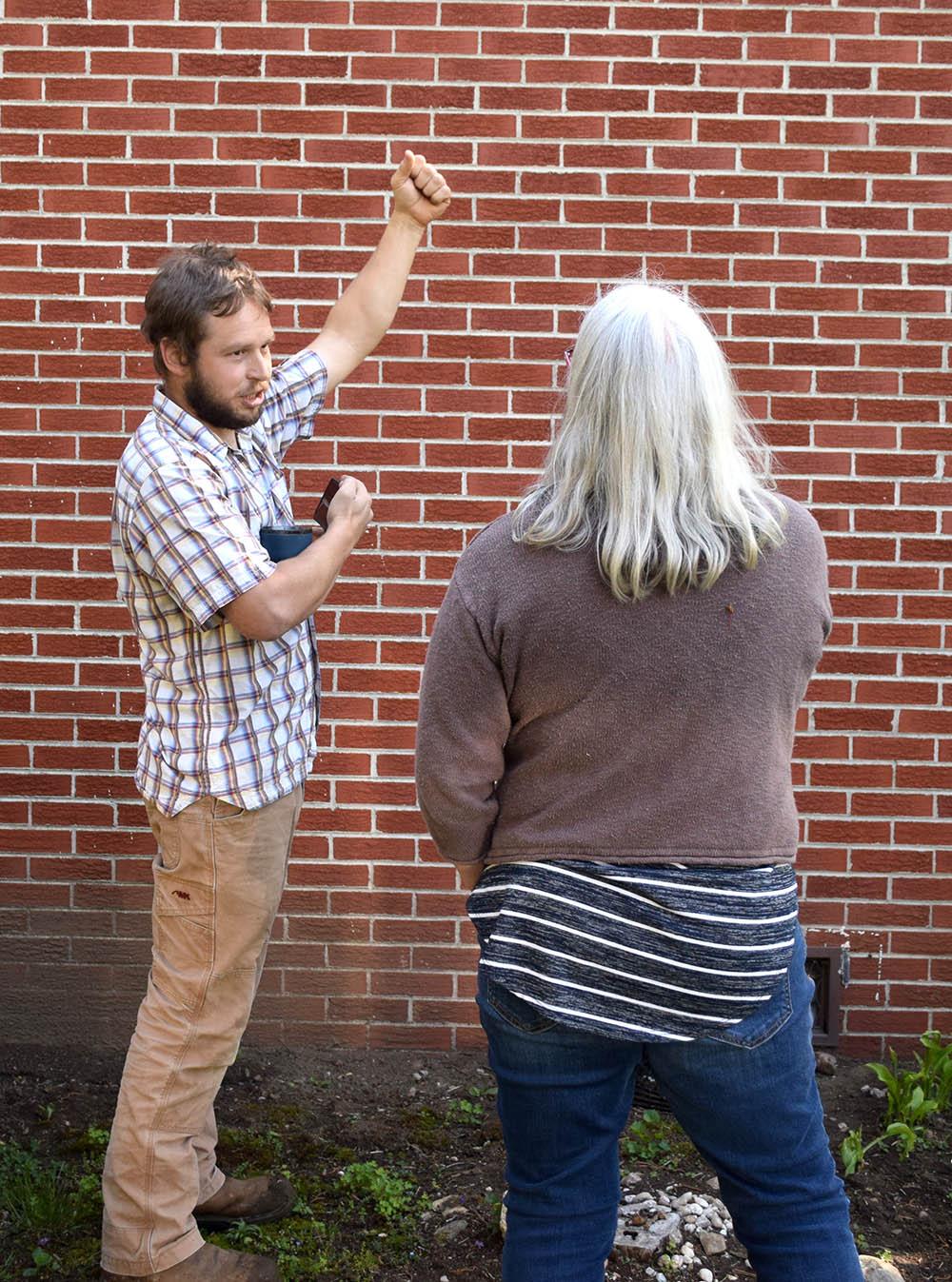 John Kidda consulting with homeowner