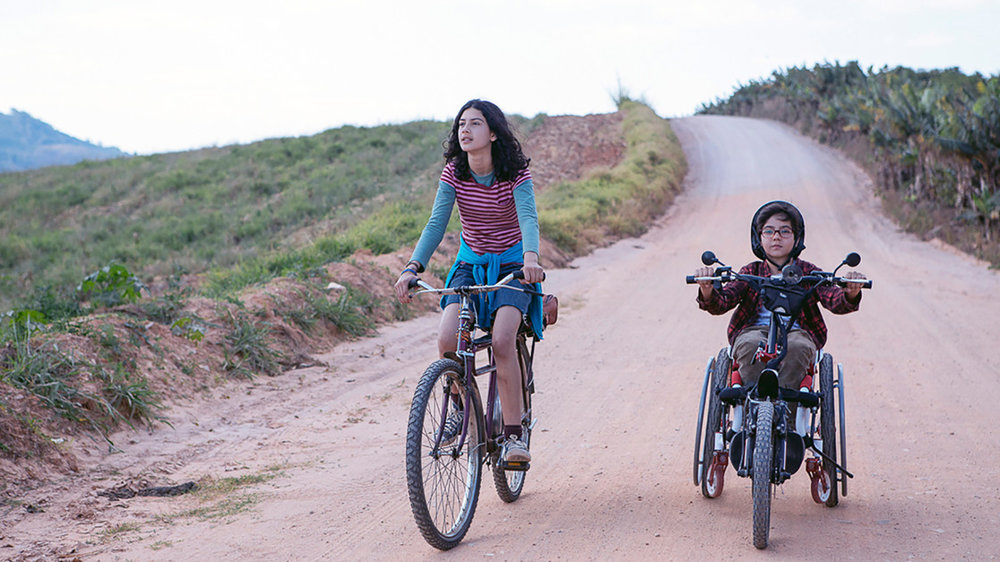 Brazil, 2017 (Portuguese with English subtitles) 75 min.   Director: Mauro D'Addio   Classification: G   Ages: 9+  After a serious accident, Lucas comes back to school in a wheel chair. Laïs, a cheerful girl, befriends the quiet boy but has troubles of her own. She's obsessed with her father, whose identity her mother hides. Lucas in his wheelchair and Laïs on her bike go searching together for her missing father.