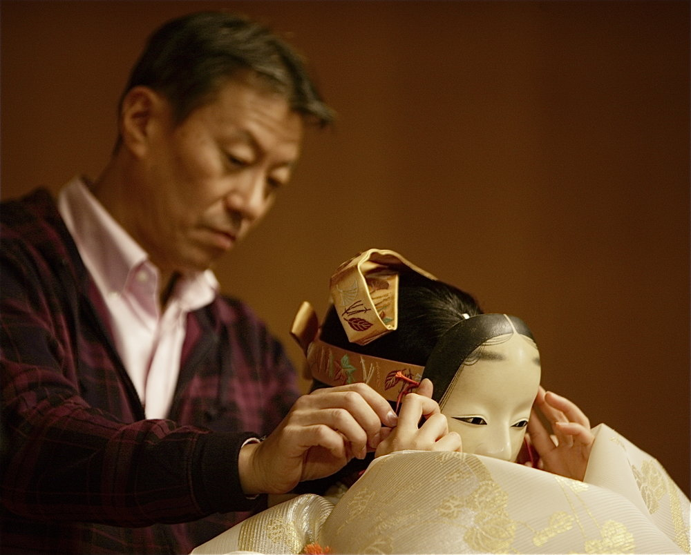Shigeru Nagashima ties the Pagoda  nochishite  mask on Kinue Oshima. Photography by Sohta Kitazawa