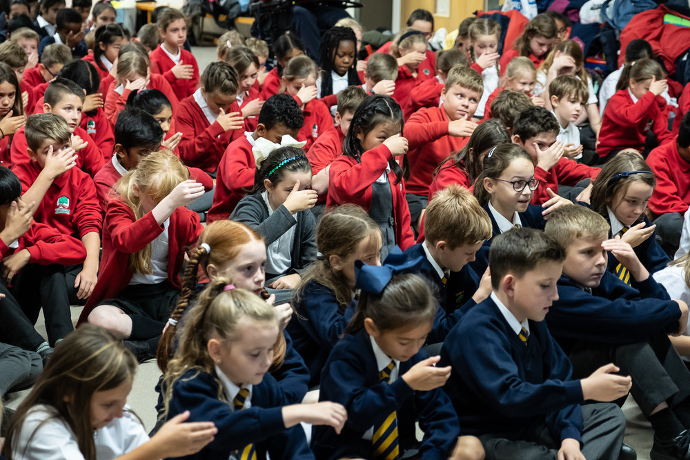 180 Coventry Primary School Children and their teachers attended a 'Getting to Noh' workshop organised by the Japan Society and the  Between the Stones  Project. Here the children are learning about the symbolic hand gesture in noh, called the 'shiori' - which demonstrates by 'scooping up their tears' signifying sadness.. Photography by Clive Barda