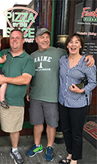 """Greg Phillips"", who turned out not to be Eddie's grandson, Eddie & Debbie in front of Frank's Pizza. -"