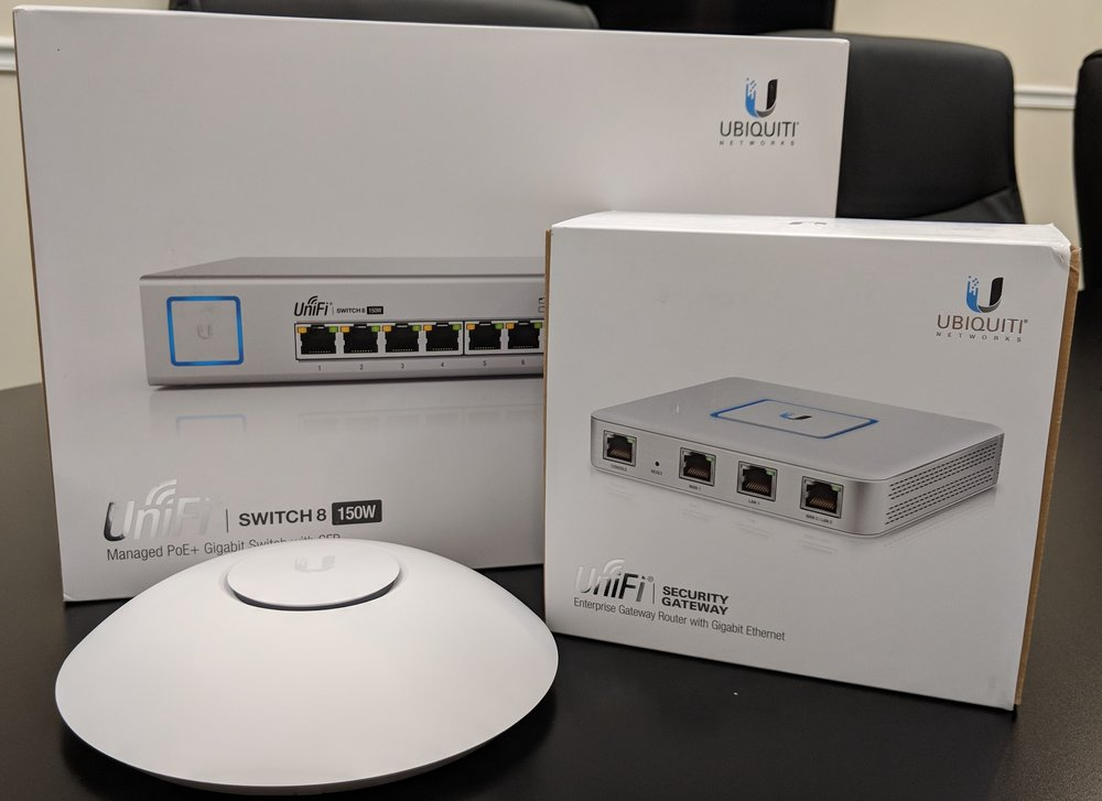 UniFi Ubiquiti networking equipment (PoE+ switch, gateway, and access point)