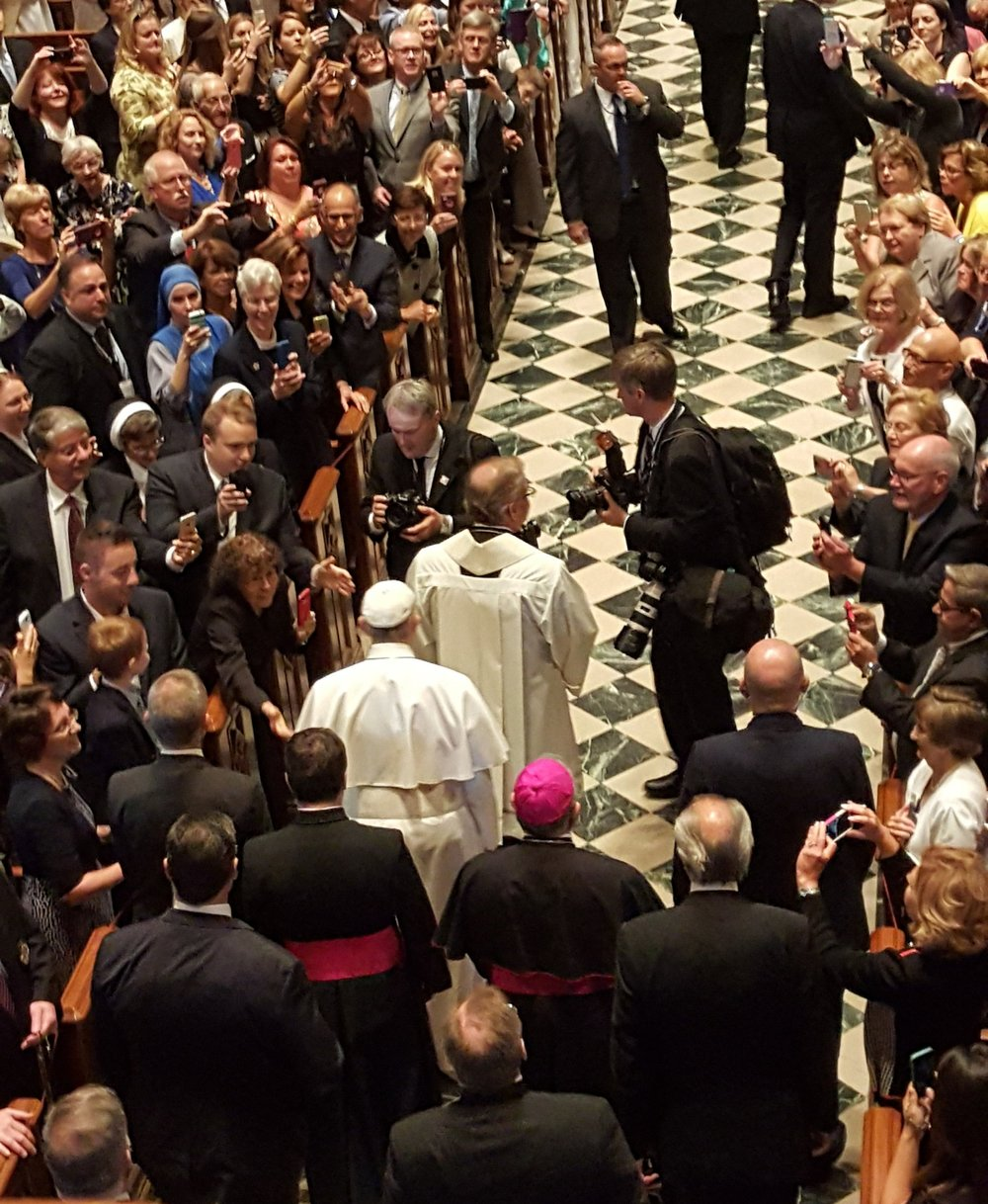 Pope Francis, lead by the Cathedral Rector Fr. Dennis Gill, enters the Cathedral to say mass.