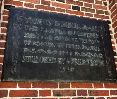 Plaque on the facade of Faneuil Hall.