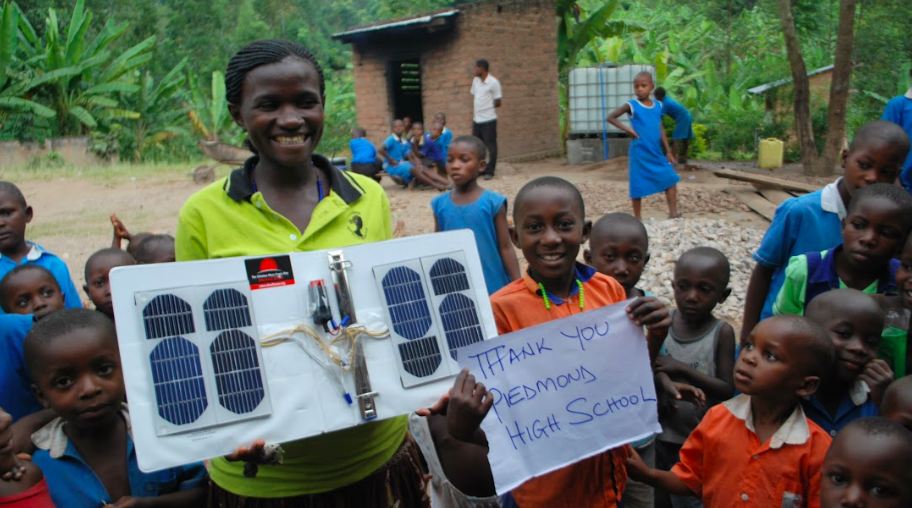 We deliver technology - we gave these solar cell phone chargers to Kanyenze Humanist Primary Schools, in Uganda