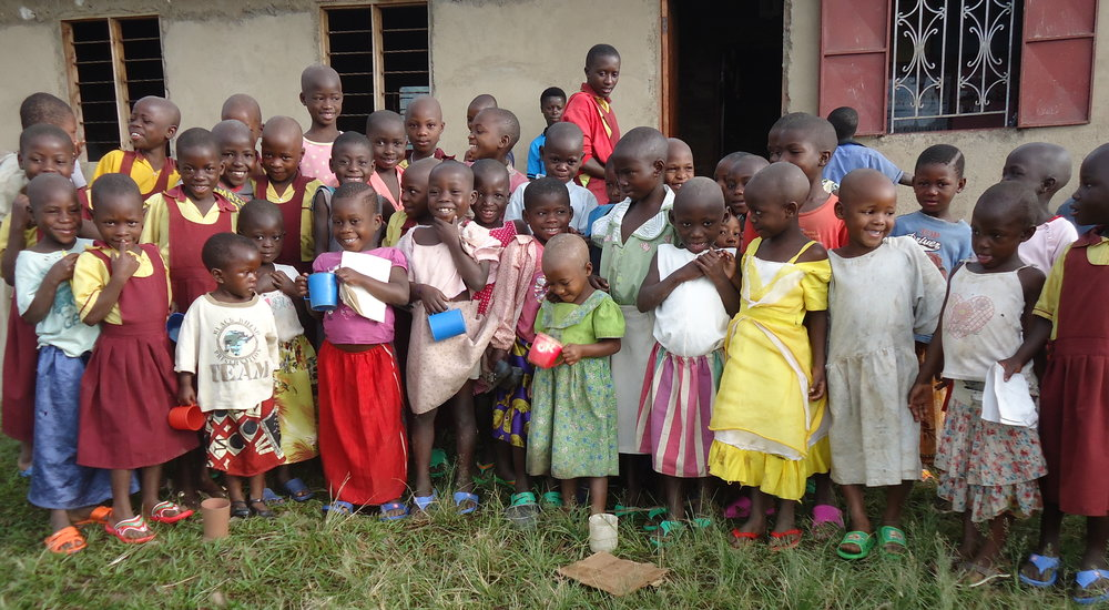 We provide lunch food, and colorful sandals, to children in the Ruwenzori mountains of central Africa