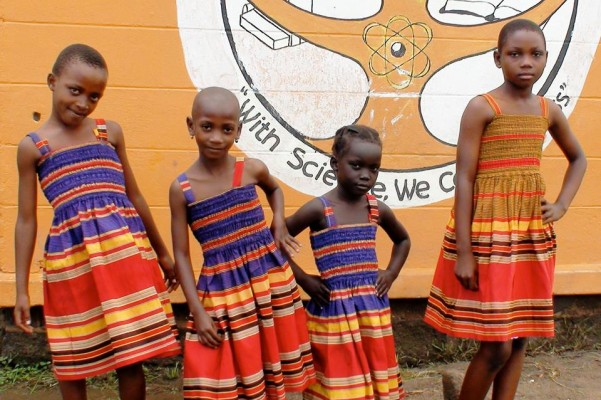 We give dresses to orphans, sewn by local tailors