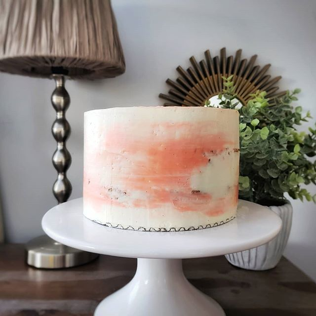 "Attempting to channel spring and experiment with flavors and icing techniques with this carrot cake. I'm calling this one the ""marbled peep show."" It's not quite naked but it's also not entirely covered. 🙈 . . . #toocold #peepshow #nakedcake #carrotcake #spring #bakelodge #patisserie #experimentation #hibernation"