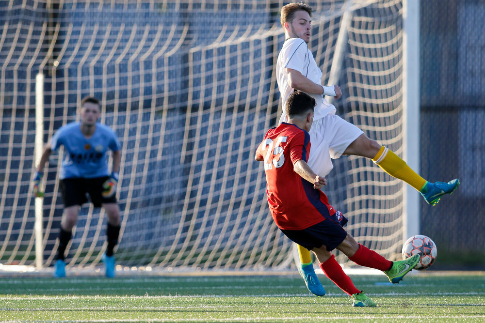 Santi Cardona tries a shot on goal, but it is deflected by a Greater Lowell FC defender. (c) Burt Granofsky