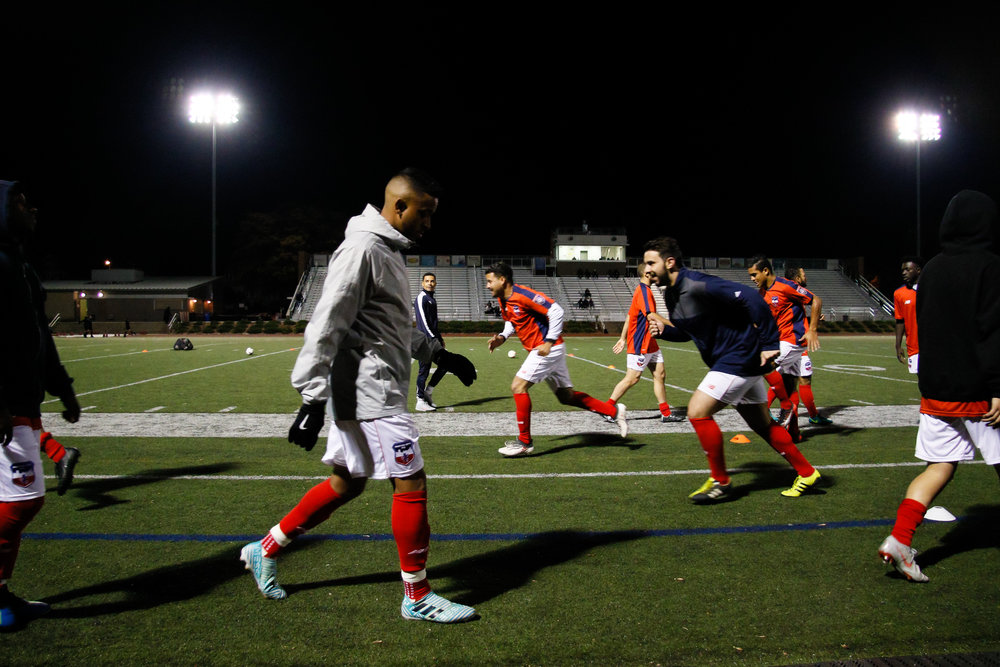 Somerville, MA: Players from Boston City FC warm up before the match. Safira FC defeated Boston City FC 4-1 in a 2019 Lamar Hunt U.S. Open Cup game on October 20, 2018. (c) Burt Granofsky