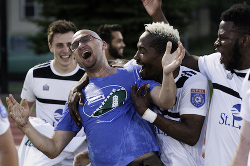 Father Tim Sas celebrates with his Duluth players.  Image courtesy of USSF.