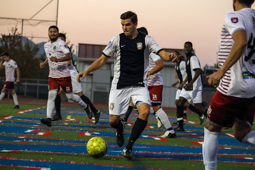 Brandon Muth takes on NPSL's Napa Valley 1839 FC (Photo via The Reporter / Courtesy Vacaville Elite)