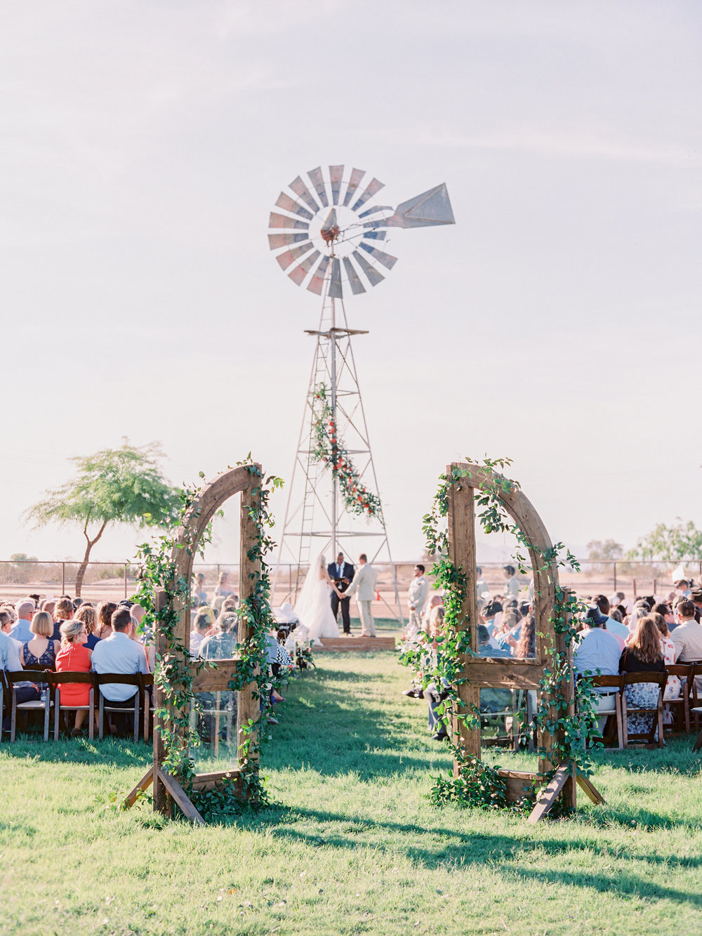 Dairy Farm Wedding - Windmill with Floral Garland Wedding Ceremony