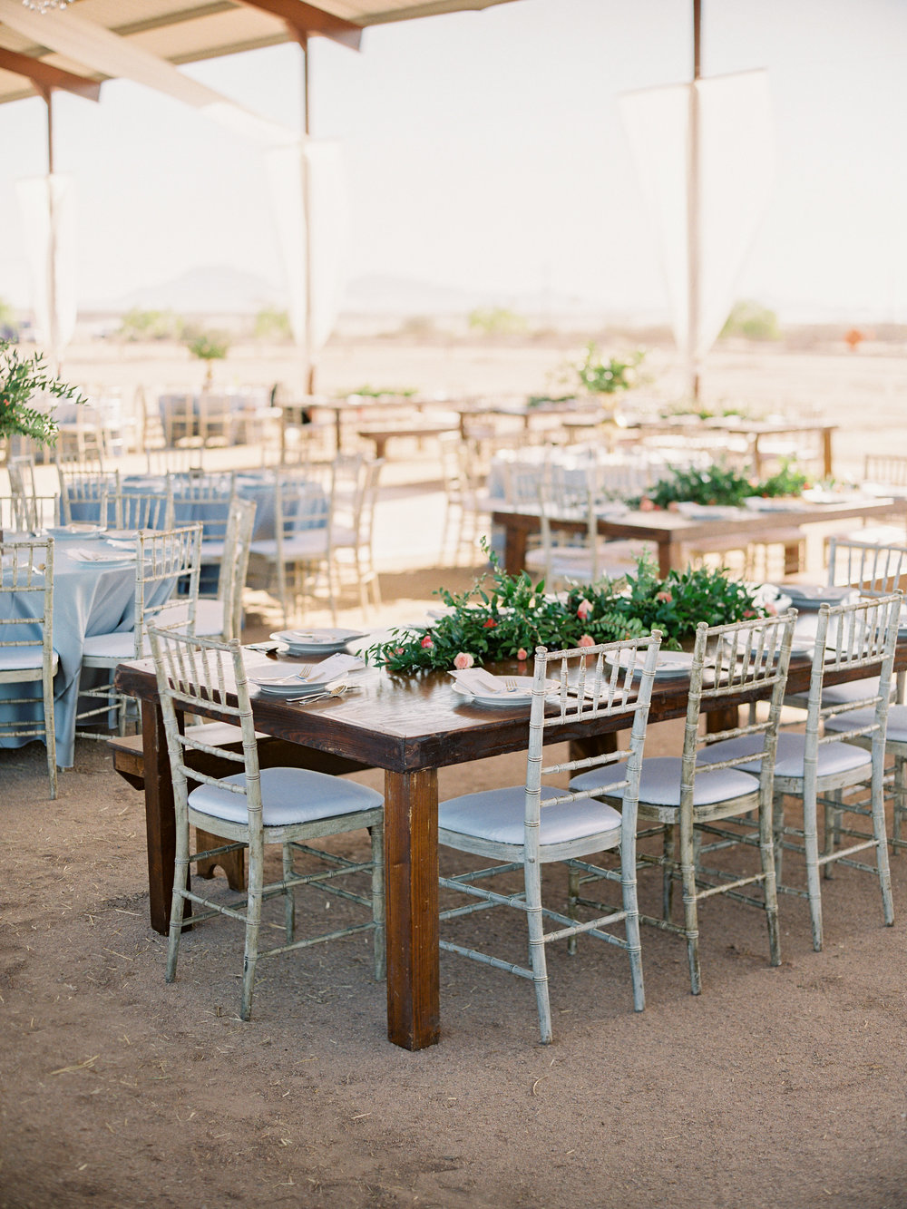 Dairy Farm Wedding - Barn Reception with Garland on Rectangular Tables
