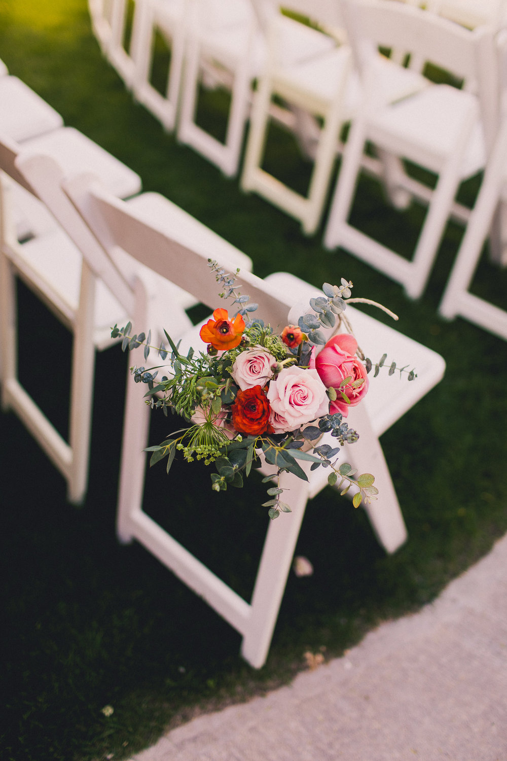 Colorful Springtime Wedding at Wrigley Mansion - Ceremony Chair Flowers