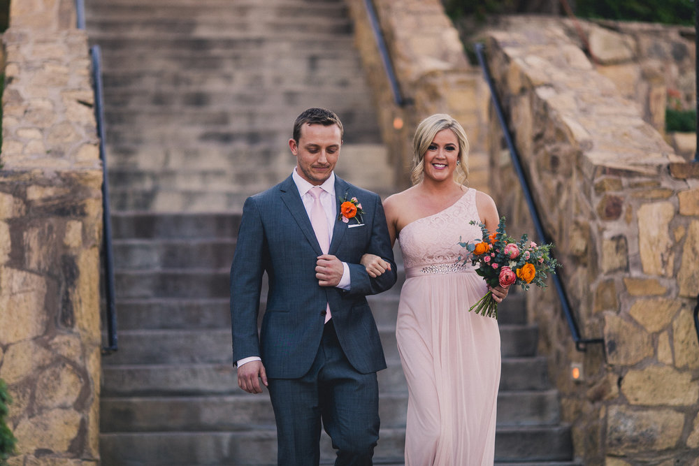 Colorful Springtime Wedding at Wrigley Mansion - Walking down the aisle