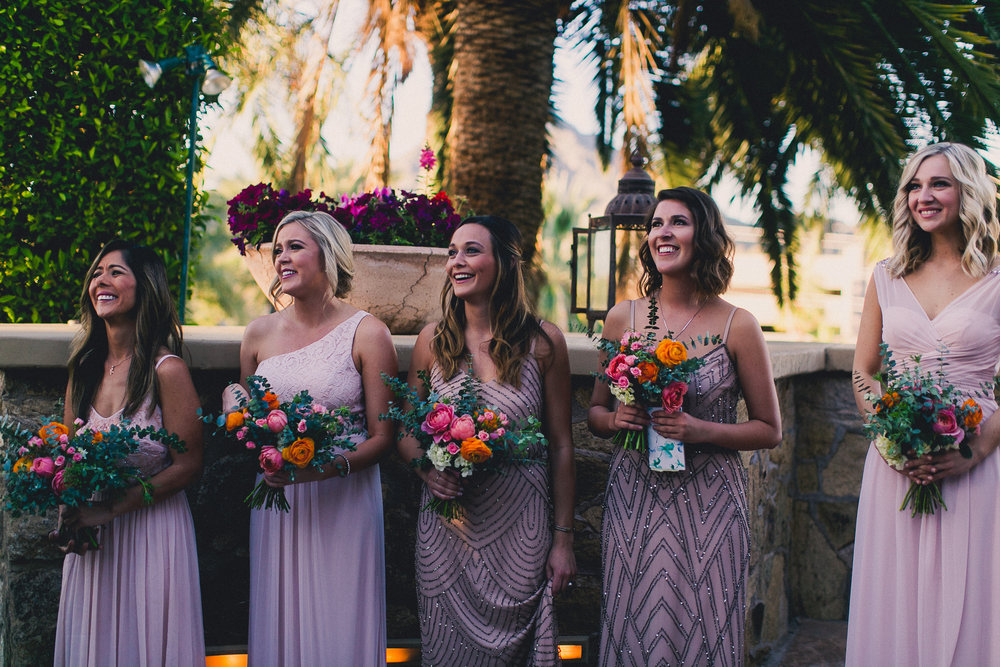 Colorful Springtime Wedding at Wrigley Mansion - Bridesmaids at Ceremony in mix and match gowns
