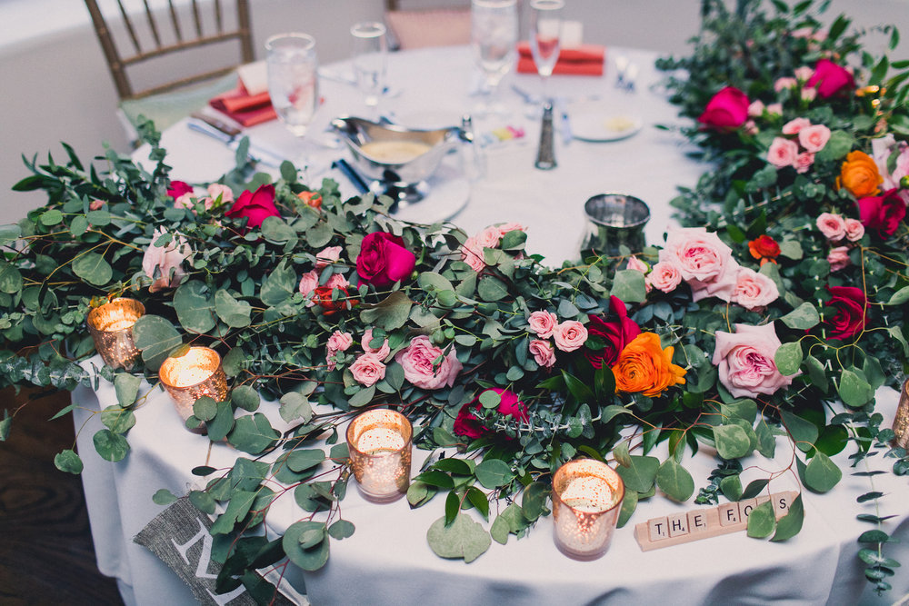 Colorful Springtime Wedding at Wrigley Mansion - Sweetheart Table Garland