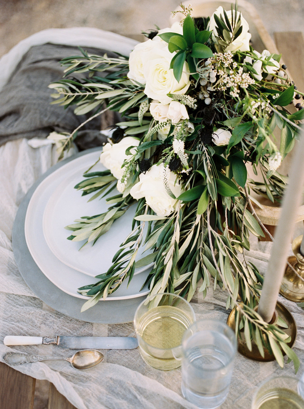 Fine Art Desert Elopement - Olive bouquet on a neutral tabletop