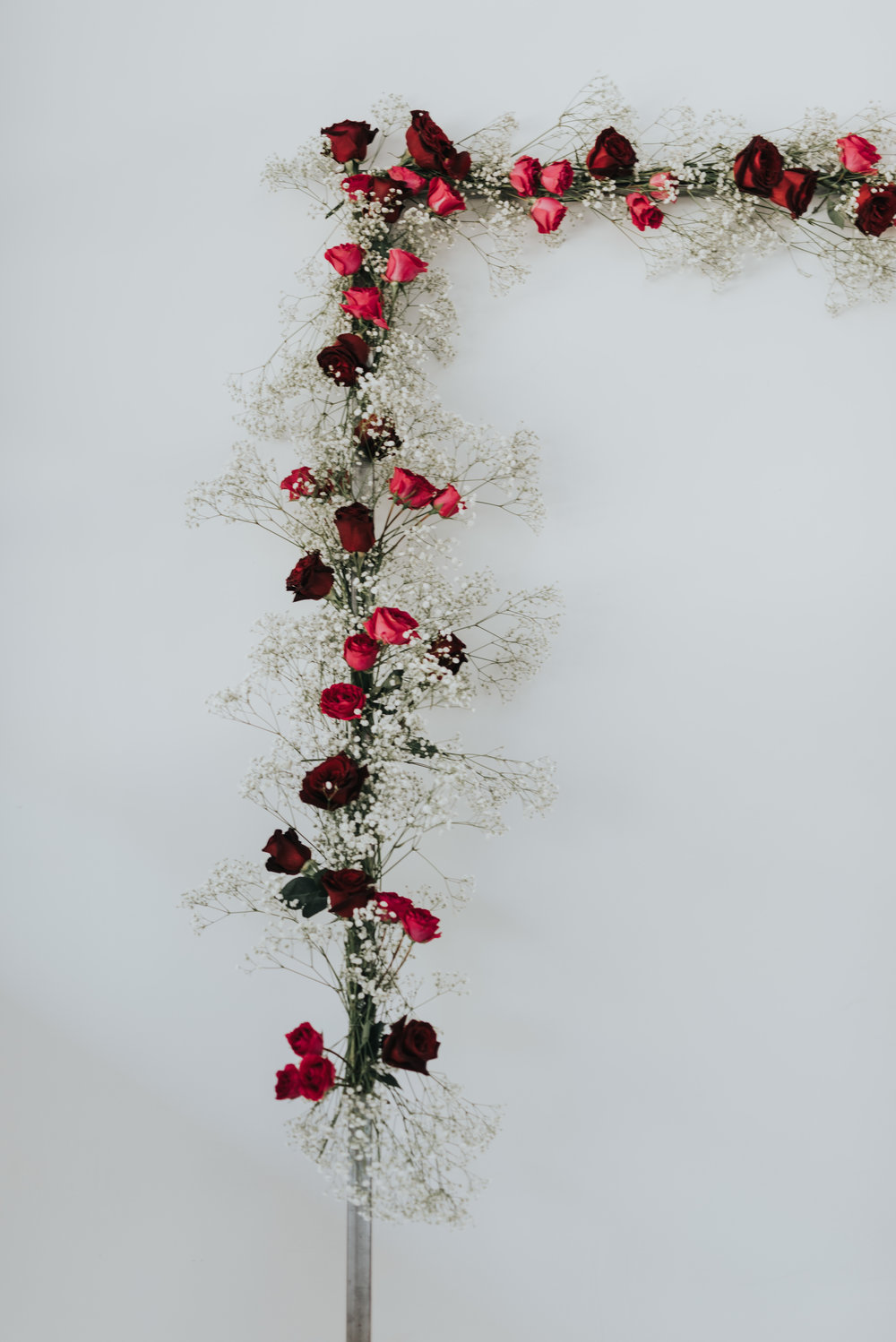 Millennial Pink Inspired Wedding - baby's breath and rose modern arch