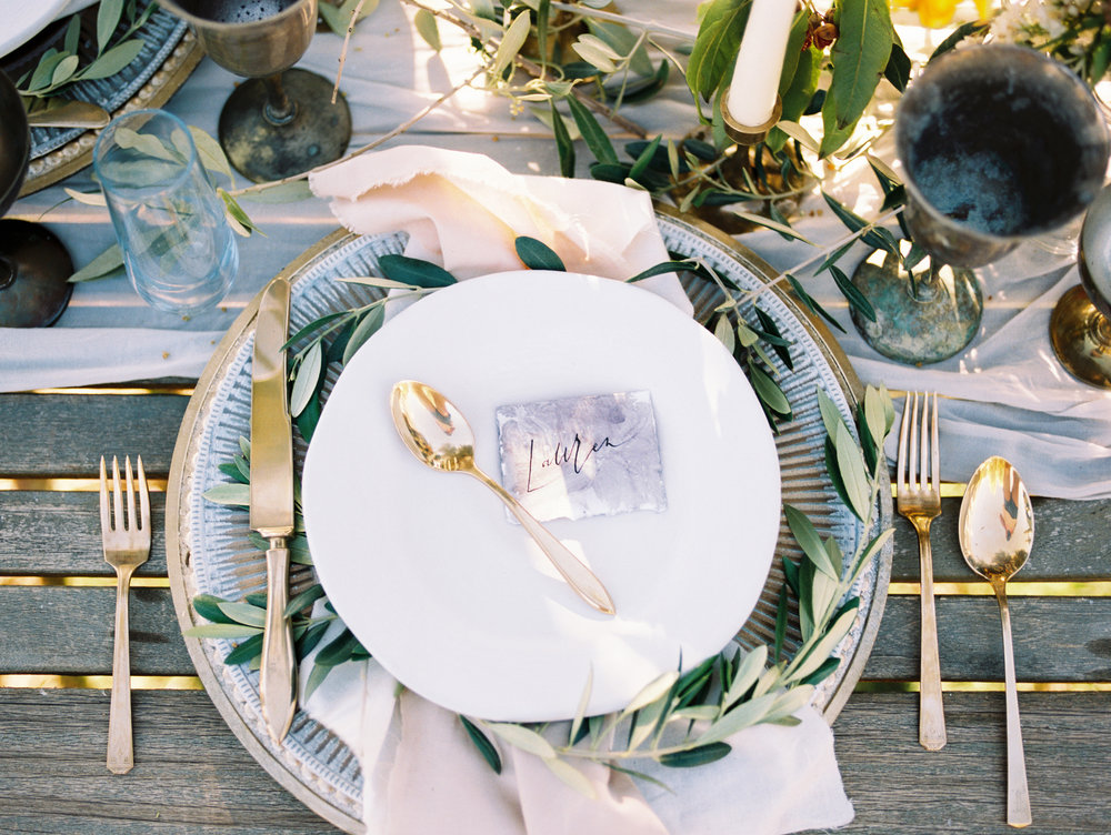 Olive Mill Wedding Inspiration - Greenery on Chargers for Guest Place Settings at Reception