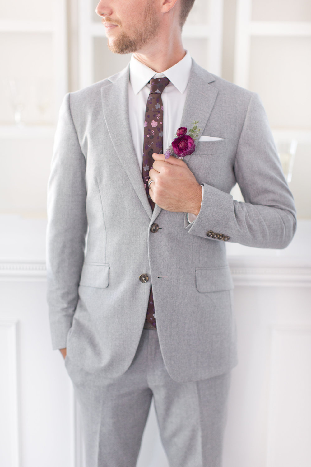 Amy & Jordan Workshop - Groom in light grey custom suit with purple boutonniere