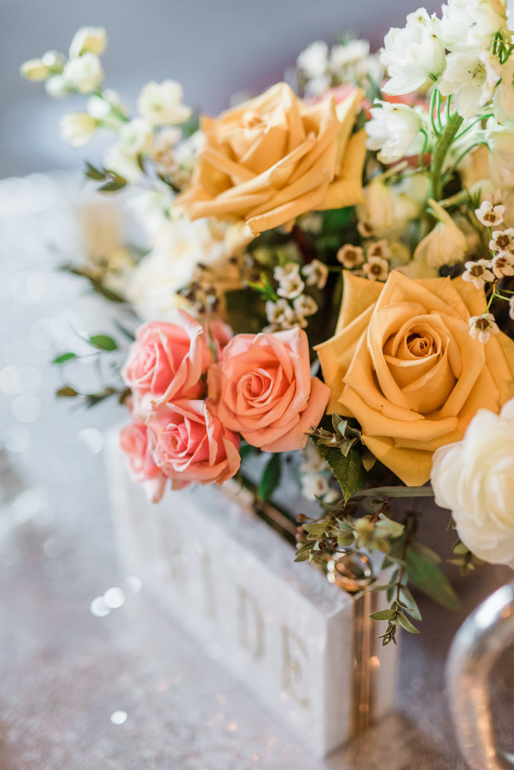 Boho Sedona Wedding - Centerpiece with gold and white flowers