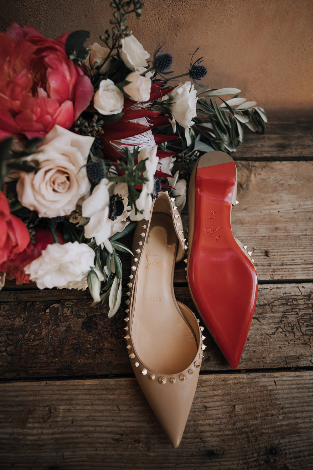 Louboutins for the bride with a peony bouquet