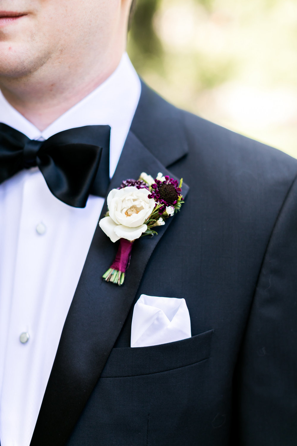 Boutonniere - Burgundy and white rose and scabiosa