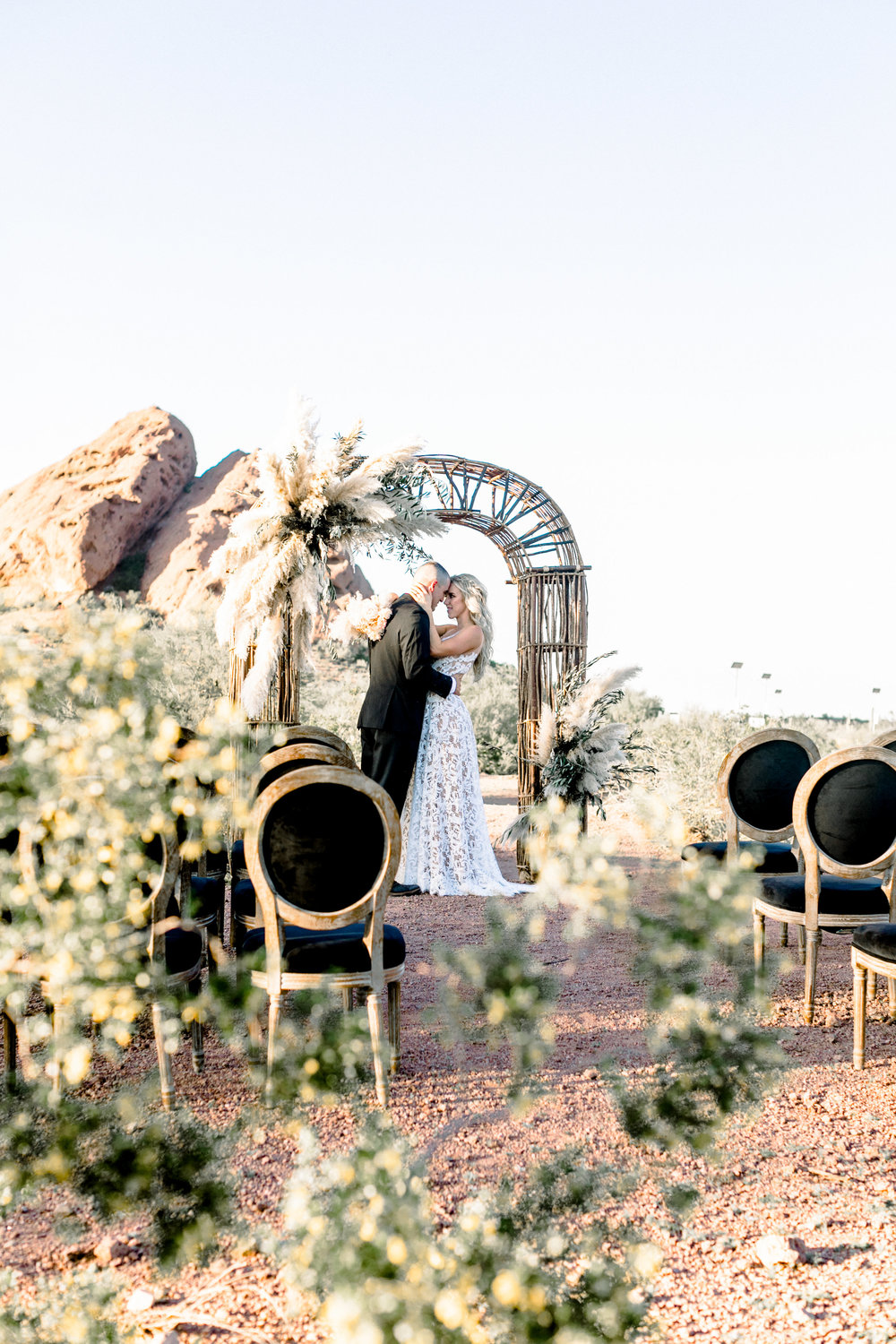 Black and Blush Fine Art Desert Wedding - Pampas Grass Arch and Black Ceremony Chairs