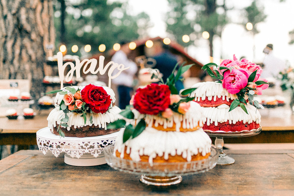 Colorful Cabin Wedding - Nothing Bundt Cakes for Wedding with Flowers and Calligraphy Wooden Topper