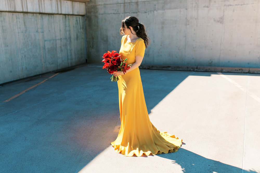 red and yellow wedding inspiration - red bouquet and yellow wedding dress by sarah seven