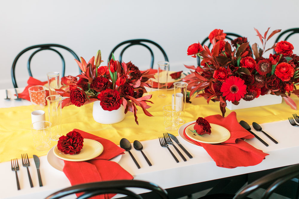 red and yellow wedding inspiration - modern black, white, red, and yellow table - reception inspiration - colorful wedding inspiration - la Tavola linen and bright event rentals