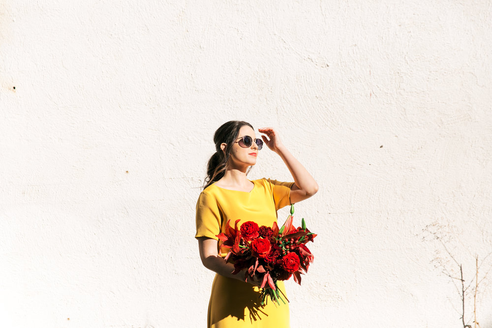 red and yellow wedding inspiration - modern black, white, red, and yellow table - yellow wedding dress - marigold sarah seven - colorful wedding inspiration