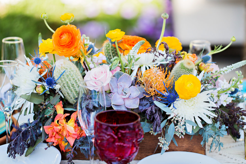 Fiesta Inspired Wedding Reception - El Chorro - Bright Centerpieces with ranunculus, mums, cactus, pincushion protea, acacia, veronica, and thistle